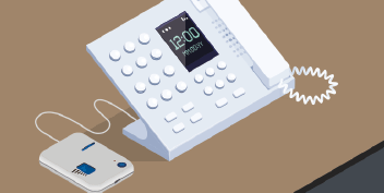 Close up of isometric telephone with dialpad and portable phone amplifier
